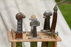 Viking sword handles in sword rack Royalty Free Stock Photo