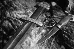 Viking sword and knife on a fur Royalty Free Stock Photo