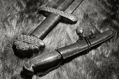 Viking sword and knife on a fur Royalty Free Stock Image