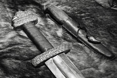 Viking sword and knife on a fur Stock Image