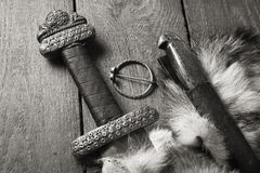 Viking sword and knife on a fur Royalty Free Stock Photos