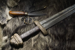 Viking sword and knife on a fur Stock Photo