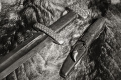 Viking sword and knife on a fur Royalty Free Stock Images