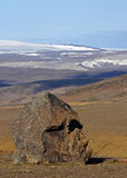 Viking head at Hofsjökull. Rock looks like viking, in thet background de Hofsjökull glacier near Kerlingarfjöll in the middle of Iceland stock photo