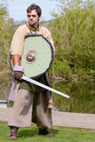 Viking warrior holding sword and shield at display Royalty Free Stock Photography