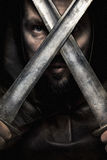 Viking warrior in hood with moustache, borded looking throught t Royalty Free Stock Images