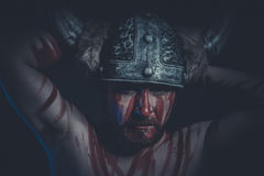 Viking warrior with a horned helmet and war paint on his face Stock Photos