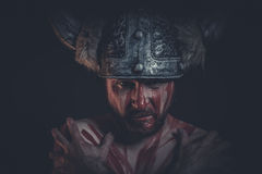 Viking warrior with a horned helmet and war paint on his face Stock Photo