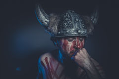 Viking warrior with a horned helmet and war paint on his face Royalty Free Stock Photo