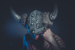 Viking warrior with a horned helmet and war paint on his face Stock Photography
