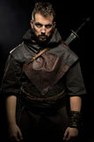 Viking warrior, male dressed in Barbarian style with sword, bear Stock Photography