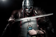 Viking warrior, male dressed in Barbarian style with sword, bear Royalty Free Stock Photo