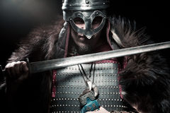 Viking warrior, male dressed in Barbarian style with sword, bear Royalty Free Stock Images
