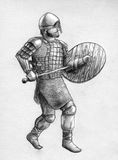 Viking warrior in scale armor. Viking warrior wearing scale armor, chainmail, wooden shield and short sword Stock Photography