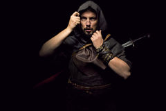 Viking warrior with sword over black background Stock Photography