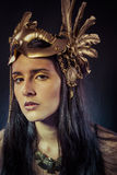 Viking, Warrior woman with gold mask, long hair brunette. Long h Royalty Free Stock Image