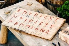 Viking week in York, 2019. Viking alphabet on a wooden board stock image