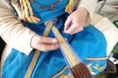 Viking woman and card weaving royalty free stock image