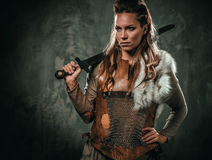 Viking woman with cold weapon in a traditional warrior clothes Royalty Free Stock Images