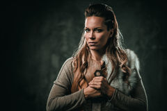 Viking woman with cold weapon in a traditional warrior clothes.  stock images