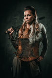 Viking woman with cold weapon in a traditional warrior clothes Royalty Free Stock Photo