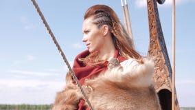 Viking woman on the Drakkar stock video
