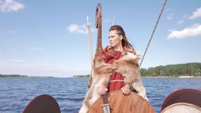 Viking woman with sword and shield on the Drakkar stock footage