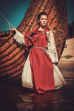 Viking woman in traditional clothes near drakkar Royalty Free Stock Photo