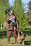 Vikings in armor with a hammer and a dog, Royalty Free Stock Photo