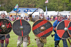 Vikings charge. STOTFOLD, ENGLAND - MAY 12: Unnamed members of the Viking re-enactors team reconstruct a typical Viking charge towards the crowd at the Stotfold Stock Images