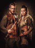 Vikings couple posing in studio on dark background. Stock Image