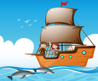 Vikings on ship and dolphins in the sea stock illustration