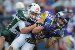 Vikings vs. Unicorns. VIENNA, AUSTRIA - MAY 17, 2015: CB Christian K�ppe (#21 Unicorns) tackles WR Dominik Bundschuh (#3 Vikings) in a game of the Big Six royalty free stock images