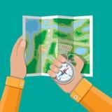 Vikt pappers- stadsöversikt och kompass i händer stock illustrationer