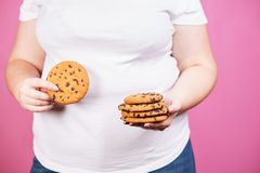 Viktförlust, övervikt, bantar, sjukligt äta royaltyfri foto