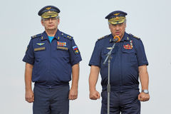Viktor Gumenny and Viktor Bondarev. ASHULUK TRAINING AREA, ASTRAKHAN REGION, RUSSIA - AUG 07, 2016: Commander of air and missile defense of Russia Viktor Gumenny Royalty Free Stock Photo