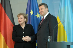 Viktor Janukowitsch with German Chancellor Angela Merkel Stock Photo