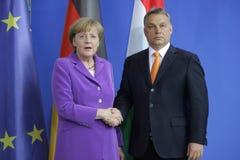 Viktor Orban, Angela Merkel images stock