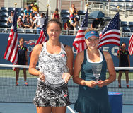 Viktoria Kuzmova (L) of Slovakia and  US Open 2016 girls junior champion Kayla Day of USA during trophy presentation Royalty Free Stock Images