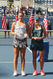 Viktoria Kuzmova (L) of Slovakia and  US Open 2016 girls junior champion Kayla Day of USA during trophy presentation Stock Photos