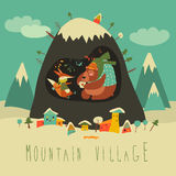Vila coberto de neve pela montanha com urso e raposa dentro da caverna Imagem de Stock