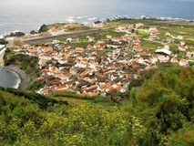 Vila do Corvo village and airstrip, Corvo island, The Azores. Panoramic view over Vila do Corvo village and the tiny airstrip on Corvo island, The Azores royalty free stock photos
