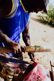 local fisherman cleaning the catch in the shade to get away from the tropical heat royalty free stock photography