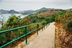 Vila do mar da ilha de Lamma que caminha a estrada, paisagem da natureza em Hong Kong Fotografia de Stock