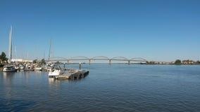 Vila Franca de Xira. Marina in Tagus river with bridge in background Stock Photography