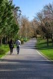 Couple going for a relaxing fitness walk in Parque da Devesa Urban Park. Vila Nova de Famalicao, Portugal - March 31, 2018: Couple going for a relaxing fitness Royalty Free Stock Photo