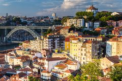 Vila Nova de Gaia apartments across from Porto, Portugal. Sun hitting Vila Nova de Gaia apartments across from Porto, Portugal with Dom Luís I Bridge stock photo