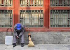 Vila rengöringsmedlet Arkivfoto