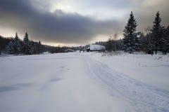 Vila russian pequena no inverno Imagem de Stock Royalty Free