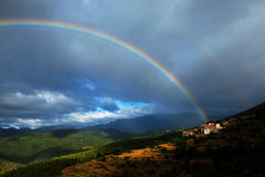 Vila sob o arco-íris Imagens de Stock Royalty Free